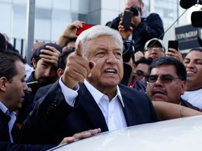 Presidential candidate Andres Manuel Lopez Obrador talks to reporters as he departs after casting his ballot at a polling station during the presidential election in Mexico City, Mexico, July 1, 2018
