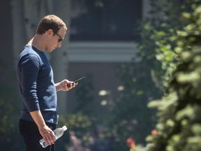 SUN VALLEY, ID - JULY 13: Mark Zuckerberg, chief executive officer of Facebook, checks his phone during the annual Allen & Company Sun Valley Conference, July 13, 2018 in Sun Valley, Idaho. Every July, some of the world's most wealthy and powerful businesspeople from the media, finance, technology and political spheres converge at the Sun Valley Resort for the exclusive weeklong conference. (Photo by Drew Angerer/Getty Images)