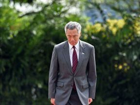 This photograph taken on June 2, 2017 shows Singapore prime minister Lee Hsien Loong at an event at the Istana presidential palace in Singapore. A feud between the children of Singapore's late founding leader intensified on June 14, 2017 after two siblings publicly accused their brother Prime Minister Lee Hsien Loong of disobeying their father's last wishes and abusing his powers. / AFP PHOTO / ROSLAN RAHMAN (Photo credit should read ROSLAN RAHMAN/AFP/Getty Images)