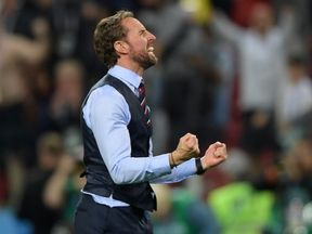 Gareth Soutgate celebrates after England's penalty success against Colombia