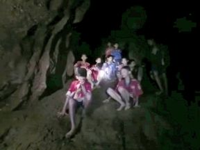 Boys from an under-16 soccer team and their coach wait to be rescued after they were trapped inside a flooded cave in Chiang Rai, Thailand