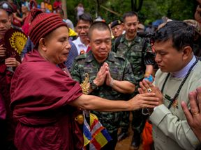 Buddhist monk Kruba Boonchum performs religious rituals to help find the missing children