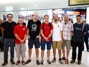 British cave divers, Rick Stanton, Chris Jewell, Connor Roe, Josh Bratchley, Jim Warny, Mike Clayton and Gary Mitchell, arrive back at Heathrow Airport, having helped in the rescue of the 12 boys in Thailand