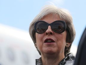 Prime Minister Theresa May, who said her controversial Brexit blueprint will safeguard millions of jobs in the aerospace industry, as she officially opened the Farnborough International Airshow