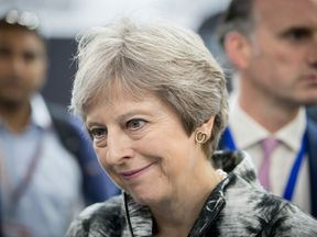 FARNBOROUGH, ENGLAND - JULY 16: British Prime Minister Theresa May speaks with guests as she opens the Farnborough Airshow on July 16, 2018 in Farnborough, England. Theresa May opened the Farnborough Airshow today with a speech pledging £300 million for a variety of research projects for the aerospace industry. Recently Bristol-based firm Airbus said it may have to move premises out of the UK after Brexit. (Photo by Matt Cardy - WPA Pool/Getty Images)