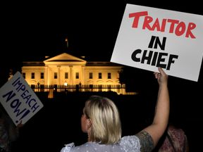 Protesters rally outside the White House after the Trump-Putin summit in Helsinki
