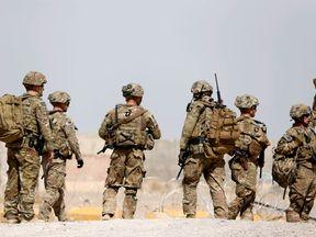 US troops walk outside their base in Uruzgan province, Afghanistan July 7, 2017
