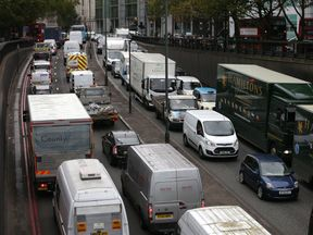 Vehicles wait in a traffic jam