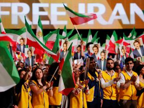 Supporters attend the anti-Iran regime rally in Villepinte, near Paris