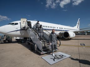 Harry Kane (R), Danny Rose (C) and Phil Jones step off the plane as England return from the World Cup