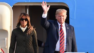 Donald Trump waves as he disembarks Air Force One