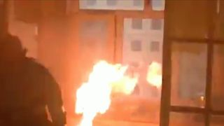 Fire fighters in China successfully remove and extinguish a flaming gas tank