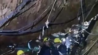 Rescue workers attempt to make a path to the stranded boys in Thailand caves