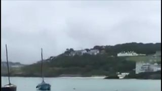 A large shark has been spotted in St Ives harbour in Cornwall, prompting safety warnings from experts.