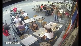 CCTV footage at a cafe in Paris shows an interaction between a woman and a man who allegedly harassed her.