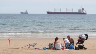 A family enjoy the weather on Tynemouth beach on North Tyneside