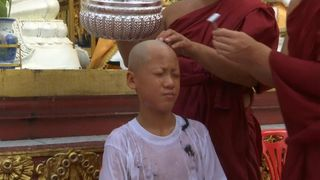 One boy's head is washing after he is shaved