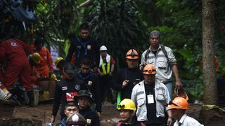 Thai rescue workers and technicians are seen at the Tham Luang cave area