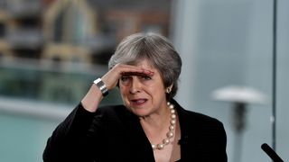 Theresa May delivers a speech at the Waterfront Hall in Belfast, Northern Ireland