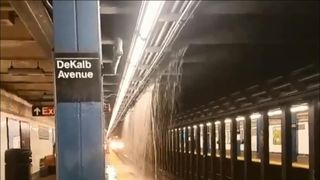 Flood waters flow through subways in two US cities