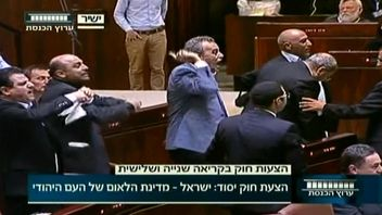 Politicians protest after controversial Israel law passes in parliament.