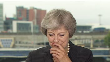 Theresa May pauses for breath during a speech on Northern Ireland and Brexit