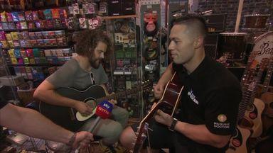 Parker enjoys guitar jam session