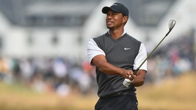 Woods on the charge with 66