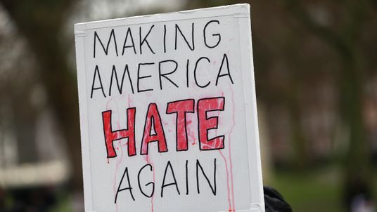 "A demonstrator holds a banner that reads ""Making America Hate Again"", during a march against U.S. President Donald Trump and his temporary ban on refugees and nationals from seven Muslim-majority countries from entering the United States, in London, Britain"