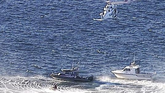 A helicopter flew the unconscious man back to land but paramedics could not revive him. Pic: 7 News