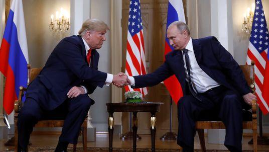 US President Donald Trump and Russia's leaer Vladimir Putin shake hands