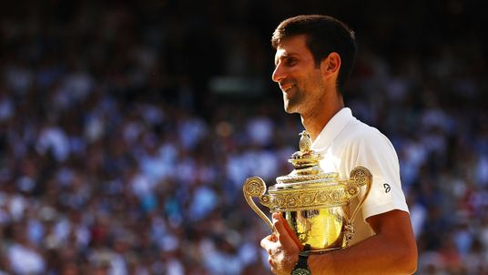 The tennis champ holds the trophy after his win against Kevin Anderson of South Africa