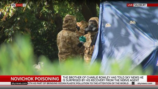 Forensic teams in protective clothing at Queen Elizabeth Gardens