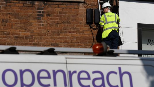 A BT openreach engineer works on a telephone line in Manchester northern England.