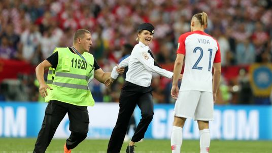MOSCOW, RUSSIA - JULY 15: Domagoj Vida of Croatia confronts a pitch invader during the 2018 FIFA World Cup Final between France and Croatia at Luzhniki Stadium on July 15, 2018 in Moscow, Russia. (Photo by Clive Rose/Getty Images)