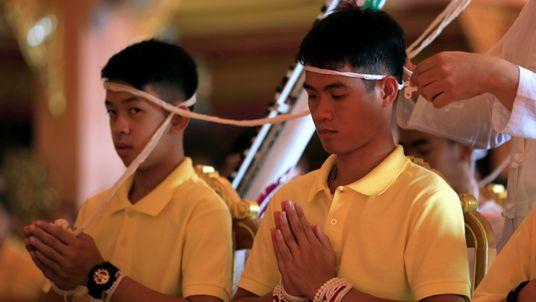 Thai boys visit temple