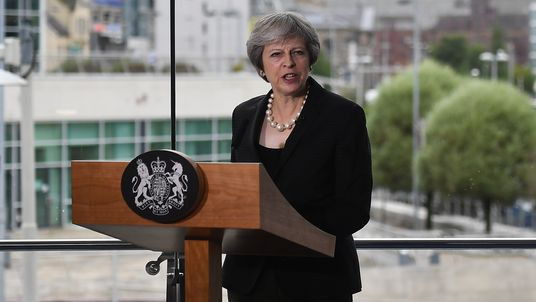 Theresa May delivers a keynote speech at the Waterfront Hall in Belfast