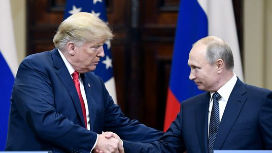 U.S. President Donald Trump (L) and Russian President Vladimir Putin answer questions about the 2016 U.S Election collusion during a joint press conference after their summit on July 16, 2018 in Helsinki, Finland. The two leaders met one-on-one and discussed a range of issues including the 2016 U.S Election collusion