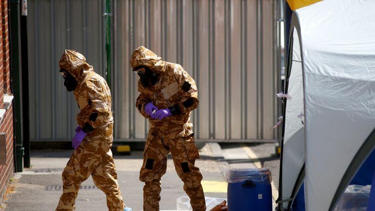 Investigators wearing hazmat suits enter the John Baker House hostel in Salisbury where Dawn Sturgess was staying