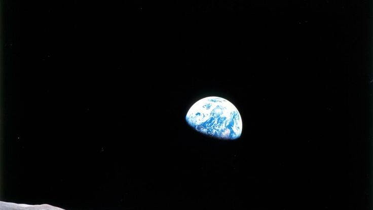The famous 'Earthrise' photo from Apollo 8, the first manned mission to the moon. The crew entered lunar orbit on Christmas Eve, Dec. 24, 1968. That evening, the astronauts held a live broadcast, showing pictures of the Earth and moon as seen from their spacecraft.