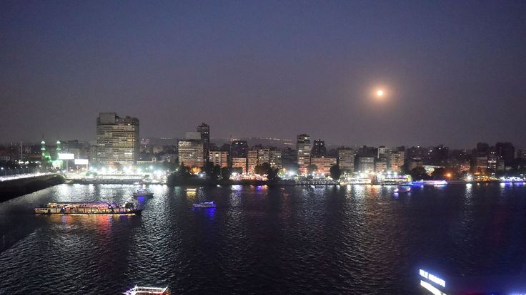 This picture shows the full moon in the sky of the Egyptian capital Cairo on July 27, 2018, prior to the expected total lunar eclipse. - The longest 'blood moon' eclipse this century began on July 27, coinciding with Mars' closest approach in 15 years to treat skygazers across the globe to a thrilling celestial spectacle. Unlike with a solar eclipse, viewers will need no protective eye gear to observe the rare display. (Photo by Khaled DESOUKI / AFP) (Photo credit should read KHALED DESOUKI/AFP/