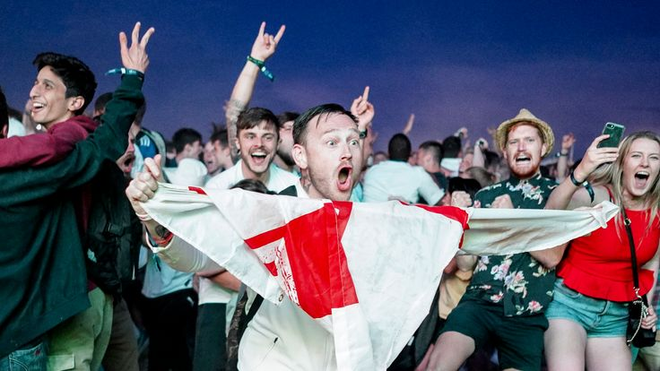 England fans celebrate as they win the penalty shoot out during the FIFA 2018 World Cup Finals match between Colombia and England