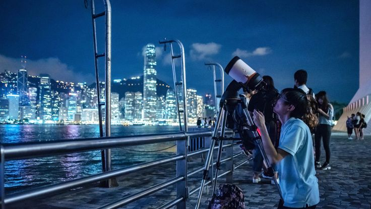 People set up telescopes to observe the lunar eclipse in Hong Kong