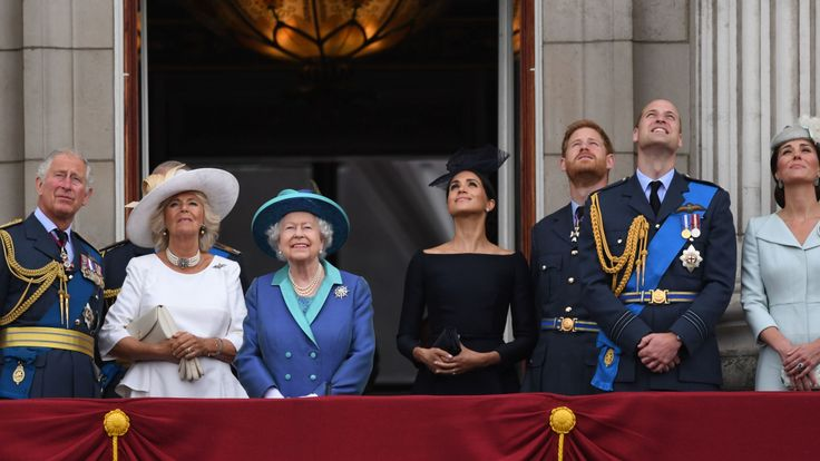 The royals watch the flypast from the balcony of Buckingham Palace
