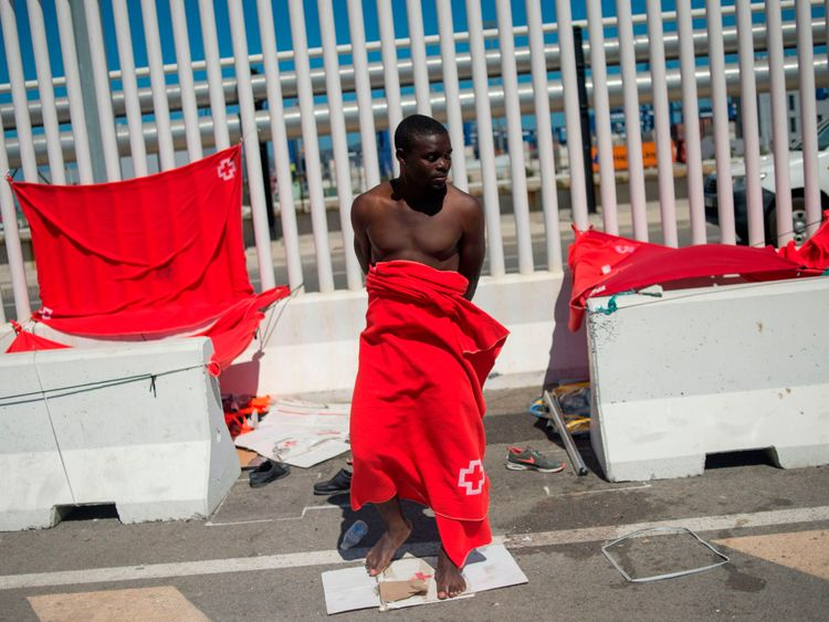 Glenn Alban, 18, from Cameroon who was rescued at sea stands at the harbour of Algeciras