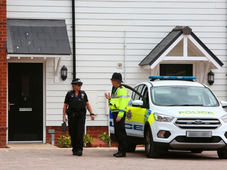 Police officers outside a residential address in Amesbury