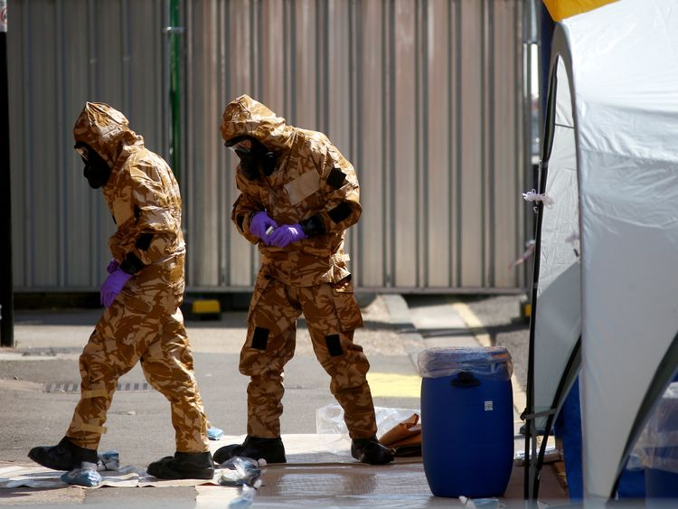 Investigators wearing hazmat suits enter the John Baker House hostel in Salisbury where Dawn Sturgess was staying