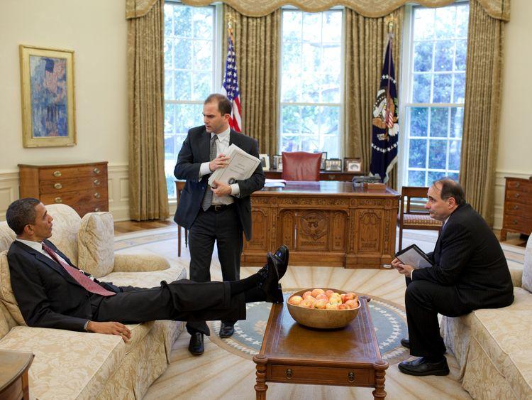 U.S. President Barack Obama talks with Deputy National Security Advisor for Strategic Communication Ben Rhodes