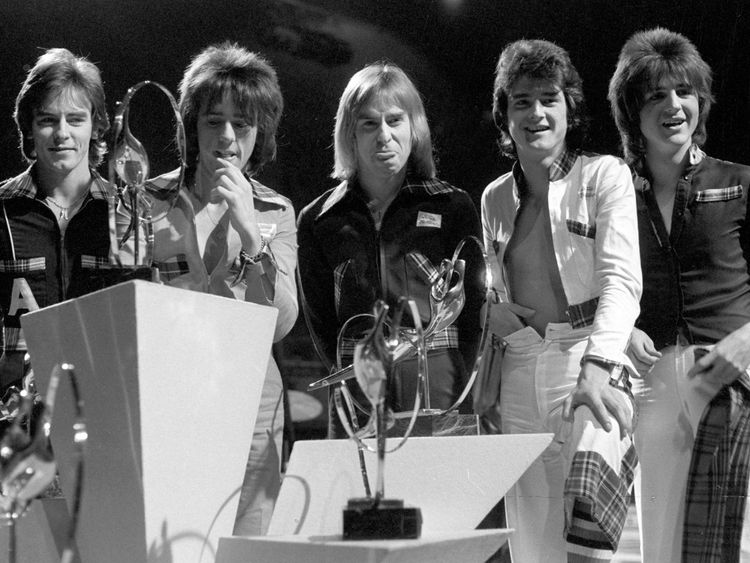 Alan Longmuir (left) with the Bay City Rollers at an awards show in Wembley in 1975