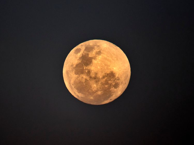 SYDNEY, NEW SOUTH WALES - JULY 27:  The full moon rises near Bondi Beach, Sydney, Australia, ahead of a total lunar eclipse. The period of totality during this eclipse, when Earth's shadow is directly across the moon and it is at its reddest, will last 1 hour, 42 minutes and 57 seconds, making it the longest viewable lunar eclipse this century.  July 27, 2018 in Sydney, Australia.  (Photo by Brook Mitchell/Getty Images)